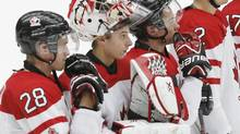 Canada's (L-R) Anthony Mantha, goalie Zachary Fucale, and Charles Hudon react following their loss to Russia in their IIHF World Junior Championship bronze medal game in Malmo, Sweden, January 5, 2014. (ALEXANDER DEMIANCHUK/REUTERS)