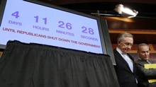 U.S. Senate Majority Leader Harry Reid (L) and Senator Charles Schumer stand next to a countdown clock while they discuss the potential U.S. government shutdown in four days, on Capitol Hill in Washington September 26, 2013. (LARRY DOWNING/Reuters)