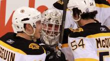 Boston Bruins goaltender Tim Thomas (centre) celebrates his 4-0 shut-out win over Ottawa with teammates Tyler Seguin (19) and Adam McQuaid (54) during NHL hockey action in Ottawa on Saturday, October 30, 2010. THE CANADIANPRESS/Fred Chartrand (FRED CHARTRAND)