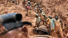 Men work in a gold mine on February 23, 2009 in Chudja, near Bunia, north eastern Congo. (LIONEL HEALING/LIONEL HEALING/AFP/Getty Images)