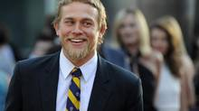 "In a Tuesday, Aug. 30, 2011 file photo, Charlie Hunnam, a cast member in ""Sons of Anarchy,"" arrives at a screening of the fourth season premiere of the television series, in Los Angeles. Hunnam will play the 27-year-old billionaire Christian Grey in the big-screen adaptation of E L James' Fifty Shades of Grey. (Chris Pizzello/AP)"