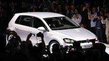 The new Volkswagen Golf model is unveiled in Berlin in this Sept. 4, 2012 file photo. Europe's mass auto makers, under siege from a market downtown and increased competition, will seek to dazzle at the Paris auto show starting on Thursday. (FABRIZIO BENSCH/REUTERS)