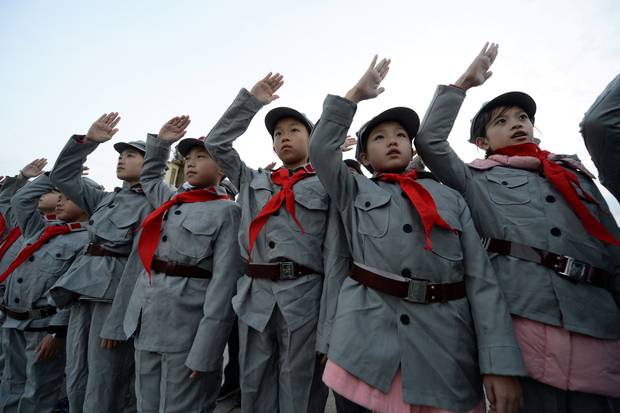 Beijing: Primary school students dressed in replica red army uniforms attend a flag-raising ceremony at Tiananmen Square.