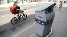 The latest assault on civic life in Canada has come with Toronto's rollout of squat, fat waste bins supplied by a private advertising company. (Kevin Van Paassen)