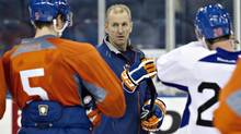Edmonton Oilers head coach Ralph Krueger talks with Ladislav Smid ,left, and Eric Belanger during the Oilers NHL training camp in Edmonton, Alta., on Monday January 14, 2013. (JASON FRANSON/THE CANADIAN PRESS)