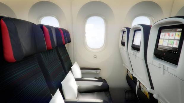 Economy seating doesn't change much in the Dreamliner, but the windows are up to 30 per cent bigger. You can also expect higher humidity levels and ambient mood lighting. (AIR CANADA)