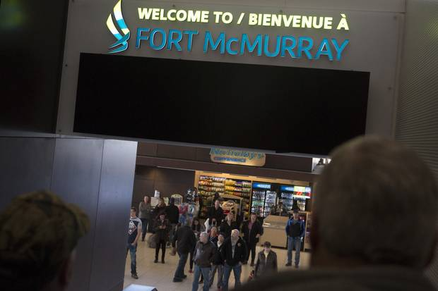 Travellers head for the baggage-claim area at the Fort McMurray airport on April 5, 2015.
