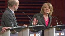 With B.C.'s Nathan Cullen looking on, Toronto MP Peggy Nash responds to a question during an NDP leadership debate in Quebec City on Feb. 12, 2012. (CLEMENT ALLARD/Clement Allard/The Canadian Press)