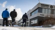 Employees arrive at the Bombardier plant, Jan. 21, 2014 in Montreal. The company announced 1,700 layoffs, 1,100 of which are in Quebec. (Paul Chiasson/THE CANADIAN PRESS)