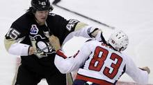 Pittsburgh Penguins' Arron Asham, left, and Washington Capitals' Jay Beagle fight during the third period of an NHL hockey game in Pittsburgh Thursday. (Gene J. Puskar/Associated Press)