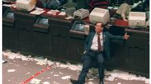 It's a day that has became known as Black Monday and for good reason. A quarter century ago – on Oct. 19, 1987 – the U.S. stock market suffered its biggest one-day drop in history. The Dow Jones industrial average swooned 508 points, or 22.6 per cent, leaving investors stunned and shaken, while triggering a worldwide rout in equity prices. Toronto stocks fell in sympathy, but only about 11 per cent, or half the decline seen on Wall Street. (Photo: A Toronto Stock Exchange trader at the end of the day on Black Monday.) (TIM CLARK/The Canadian Press)