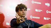 In this file photo, Milos Raonic of Canada speaks during a press conference after his opponent Andy Murray of Great Britain pulled out of the tournament for a knee injury on the fourth day of the Rogers Cup tennis tournament in Toronto on Thursday August 9, 2012. World No. 15 Milos Raonic of Thornhill, Ont., will compete in this year's Rogers Cup men's competition in Montreal. (Aaron Vincent Elkaim/THE CANADIAN PRESS)