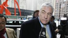 Former media mogul Conrad Black arrives at federal court in Chicago, for a status hearing in his bid to remain free, as Black was released last year from a Florida prison while he appealed his conviction for defrauding Hollinger International Inc., investors. The U.S. Supreme Court has rejected an appeal from Black challenging his two remaining convictions on fraud and obstruction of justice, The Associated Press reports Tuesday, May 31, 2011. (Charles Rex Arbogast/AP)