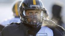 Hamilton Tiger-Cats' quarterback Kevin Glenn (5) watches from the sidelines in the second half of the East Final against the Winnipeg Blue Bombers' in CFL football action in Winnipeg, Sunday, November 20, 2011. THE CANADIAN PRESS/Trevor Hagan (Trevor Hagan/CP)