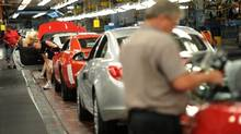 File photo of workers on a General Motors line in Oshawa, Ont. (Kevin Van Paassen/The Globe and Mail)