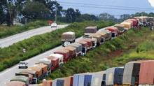 Hundreds of trucks carrying soybeans are lined up for more than 100 kilometres along a highway next to the port of Paranagua, in the southeastern Brazilian city of Curitiba, in this file photo. Brazil has failed to make use of its extensive river network, one reason why its transport costs are up to four times higher than in the United States or Argentina. (STRINGER/BRAZIL/REUTERS)