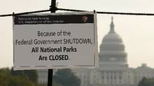 A sign on the National Mall tells visitors of the closings do to the federal government shutdown in Washington. (Kevin Lamarque/Reuters)