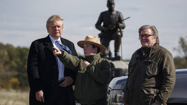 Interpretive park ranger Caitlin Kostic, center, gives a tour near the high-water mark of the Confederacy at Gettysburg National Military Park to Donald Trump, left, and campaign CEO Steve Bannon, Saturday, Oct. 22, 2016, in Gettysburg, Pa.