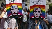 Activists holding placards depicting Russian President Vladimir Putin, participate at a protest against Russia's new law on gays, in central London, Saturday, Aug. 10, 2013. (Lefteris Pitarakis/AP)