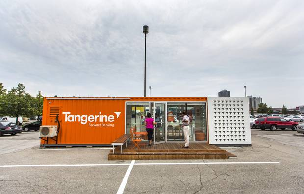 People walk into a Tangerine temporary bank branch in the Centerpoint Mall parking lot in Toronto on Aug. 18, 2015.