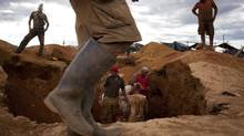Illegal miners dig in search of gold in a makeshift camp near Tumeremo in Venezuela's southern Bolivar state in this July 15, 2010 file photo. (Carlos Garcia Rawlins/Reuters)