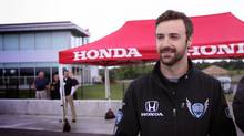 IndyCar driver James Hinchcliffe stands on the track at the Canadian Tire Motorsport Park in Bowmanville, Ont. on Tuesday, July 15, 2014. (Katherine Scarrow/The Globe and Mail)
