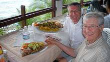 Bill and John Tossell go ashore for lunch in Costa Rica. (Victor Dwyer)