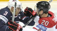 U.S. Jack Johnson, left, stops Canada's John Tavares in their preliminary round match Canada vs USA during the 2012 IIHF Ice Hockey World Championships in Helsinki, Saturday, May 5, 2012. (AP Photo/Lehtikuva/Antti Aimo-Koivisto) (Antti Aimo-Koivisto)