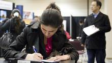 A Job Seeker fils out a form at the Bi-lingual Job Fair and Training Expo in Toronto on Thursday March 8, 2012 . (Chris Young for The Globe and Mail/Chris Young for The Globe and Mail)