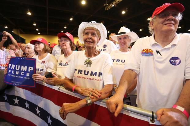 Supporters listen to Mr. Trump in Phoenix on Wednesday night.
