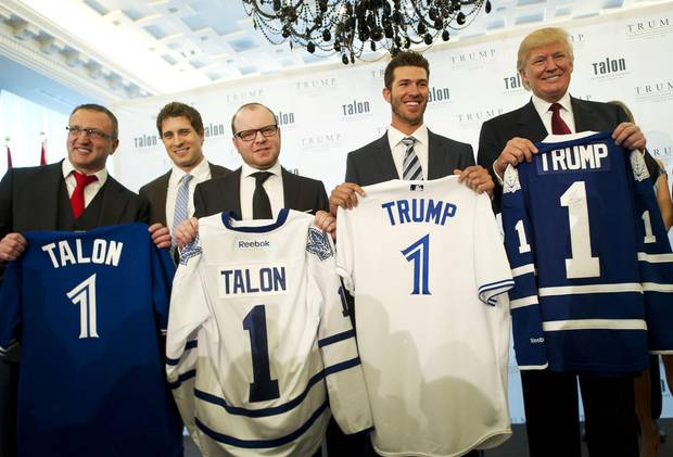 At the same event: from left, Talon International CEO Val Levitan, Toronto Maple Leafs defenceman John-Michael Liles, Talon International Chairman Alex Shnaider, Toronto Blue Jays' J.P. Arencibia and Donald Trump hold up Blue Jays' and Maple Leafs' jerseys at the grand opening.