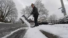 With his home on a corner lot, Gordon Isbister had to shovel close to 200 feet of sidewalk on Nov. 27, 2013. (FRED LUM/THE GLOBE AND MAIL)