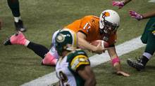 B.C. Lions' quarterback Buck Pierce dives across the goal line to score a touchdown against the Edmonton Eskimos during the second half of a CFL football game in Vancouver, B.C., on Friday October 25, 2013. (DARRYL DYCK/THE CANADIAN PRESS)