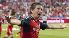 Toronto FC's Terry Dunfield reacts after scoring the game wining goal against the Vancouver Whitecaps FC during the second half of their MLS game in Toronto, July 11, 2012. (FRED THORNHILL/REUTERS)