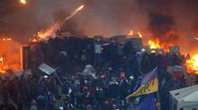 Anti-government protesters clash with riot police at Independence Square in Kiev February 19, 2014. Ukrainian riot police fought protesters occupying the central Kiev square early on Wednesday after the bloodiest day since the former Soviet republic, caught in a geopolitical struggle between Russia and the West, won its independence. (Vasily Fedosenko/Reuters)