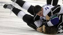 Vancouver Canucks right wing Alex Burrows (14) pins Los Angeles Kings centre Anze Kopitar to end a fight during the second period of Game 3 in a first-round NHL Stanley Cup playoff series in Los Angeles, Sunday, April 15, 2012. (Alex Gallardo/Alex Gallardo / AP)