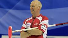 Skip Glenn Howard smiles during play at the World Men's Curling Championship 2012 in Basel April 4, 2012. (ARND WIEGMANN/REUTERS)