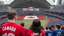 Toronto Blue Jays fans stand for the playing of the national anthems before AL action between the Toronto BLue Jays and Detroit Tigers on Canada Day (Frank Gunn/THE CANADIAN PRESS)