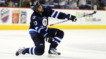 Winnipeg Jets defenseman Dustin Byfuglien (33) celebrates his goal during the second period against the Dallas Stars at MTS Centre. (Bruce Fedyck/USA Today Sports)