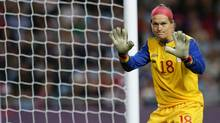 Norwegian referee Cristina Pedersen ruled Canadian goalkeeper Erin Mcleod  had violated FIFA's six second rule which resulted in a controversial call and eventual equalizing goal by the United States in Monday's women's Olympic semi-final. (Armando Franca/The Associated Press)