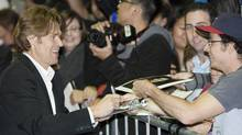 "Actor Willem Dafoe signs autographs as he arrives at the ""Antichrist"" film gala at the Toronto International Film Festival on Sept. 11, 2009. (MARK BLINCH)"