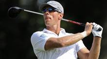 Graham DeLaet, of Canada, watches his drive on the 18th hole during the third round of the Travelers Championship golf tournament in Cromwell, Conn., Saturday, June 22, 2013 (Associated Press)