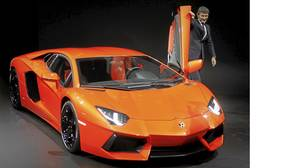 Stephan Winkelmann, CEO and President of Lamborghini, presents the new model Aventador LP700-4 during a Volkswagen group presentation prior to the Geneva auto show.