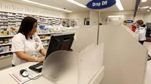Shoppers Drug Mart's prescription and drug counter at a Toronto outlet. (Deborah Baic/Deborah Baic)