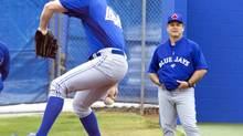 Toronto Blue Jays pitcher Casey Janssen throws from the practice mound as manager John Gibbons looks on at the team's MLB spring training facility in Dunedin, Florida February 14, 2013. (FRED THORNHILL/REUTERS)