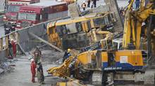 Images from the scene at York University in Toronto where a tracked excavation crane apparently fell over onto another piece of machinery at approximately 2:40pm on Oct. 11, 2011, killing one man and injuring several people on the ground. (Peter Power/Peter Power/The Globe and Mail)
