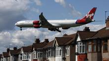 A Virgin Atlantic aircraft comes in to land at Heathrow Airport in London on May 26, 2009. (LUKE MACGREGOR/REUTERS)