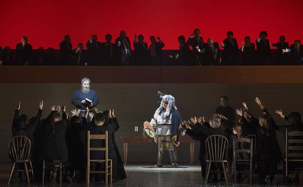 A chorus of indigenous performers onstage throughout the opera are clothed in a sea of red, and then, at a critical moment, change to black.