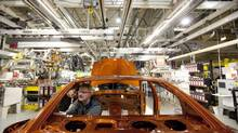 Chrysler employees work on the assembly line at the plant in Brampton, Ont. on January 7, 2011. (DARREN CALABRESE/THE CANADIAN PRESS)