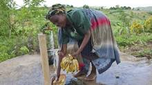 Esnat John, a farmer in Malawi, says the tap installed in her village as part a Canadian-funded water project has prevented deaths from cholera. (Erin Conway-Smith For The Globe and Mail)
